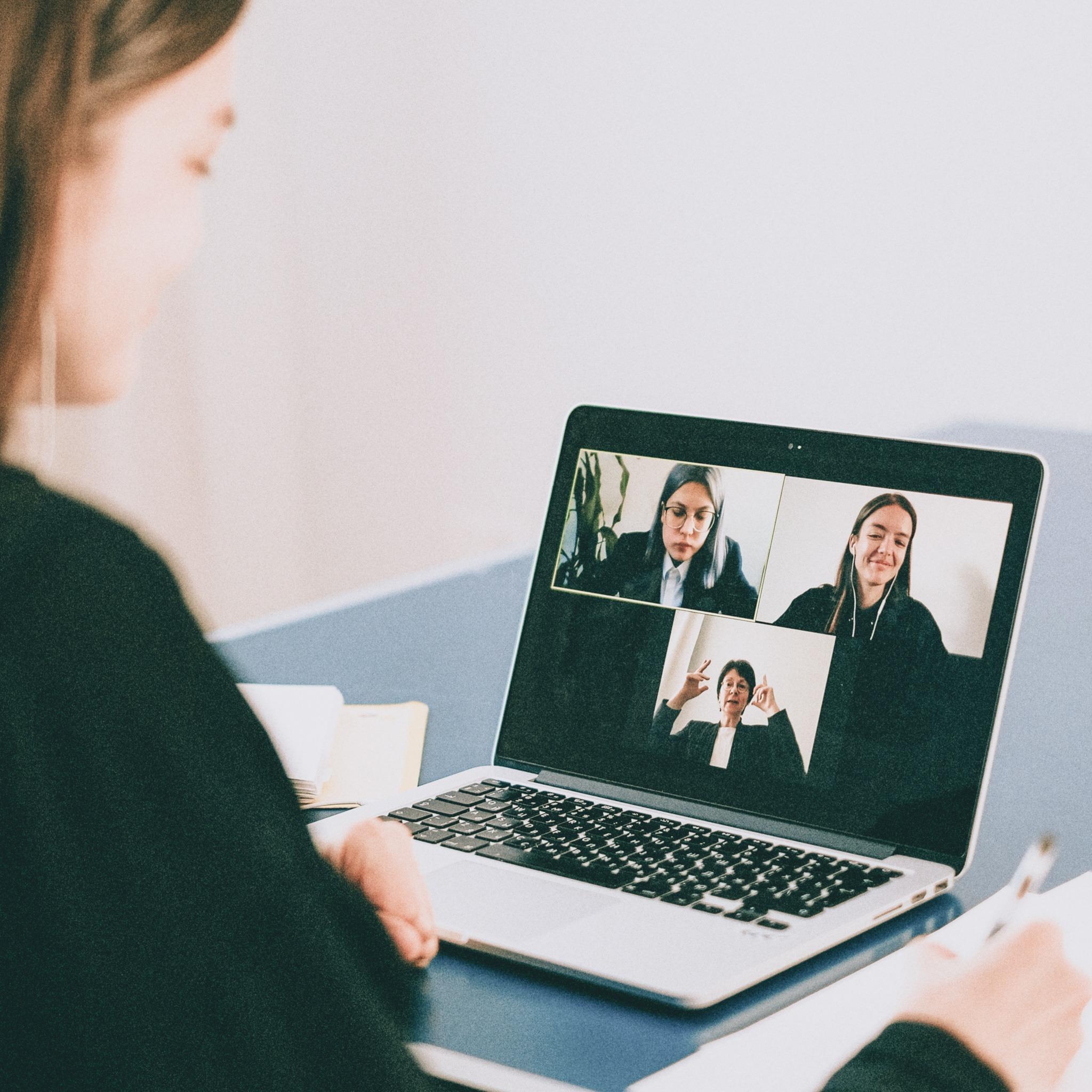 Photo of three women in a virtual meeting.